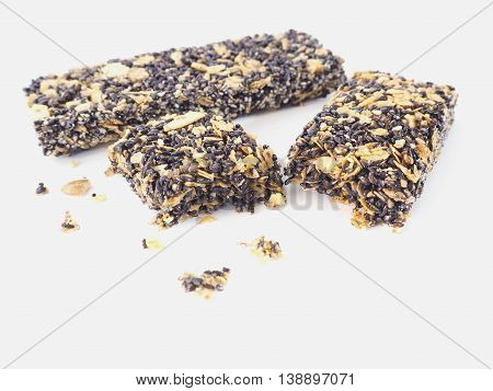 Healthy granola. Organic munchies bars on white background.