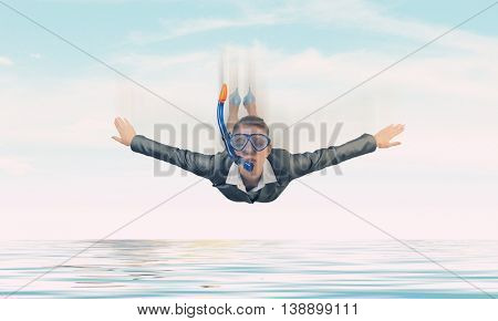 Businesswoman diver in free fall . Mixed media