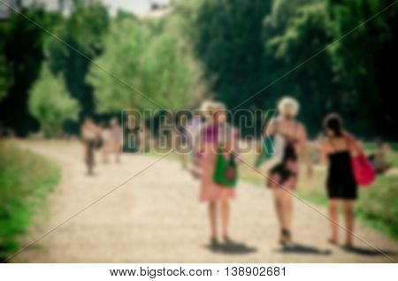 Abstract Blurred Activity Of Friend Group Near The Isar River, Munich City, Germany