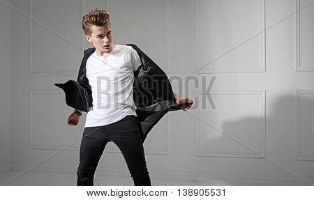 Young fashionable man posing