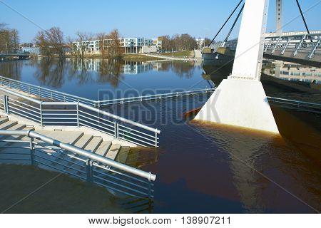 Footpath under water flooding in Tartu Estonia.