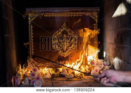 The Buddhist Thai cremation chamber and hand of undertaker