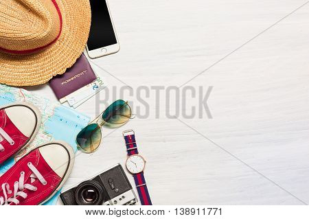 The travel and clothing accessories apparel for the men on white wooden background. The travel, tourism and holidays concept