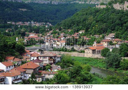 VELIKO TARNOVO BULGARIA - JUNE 26 2016: Residential area of Veliko Tarnovo Tsarevets fortress wall and the Yantra river