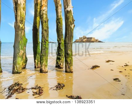 Breakwaters in low tide and Fort National. Seashore Saint-Malo, Brittany, France