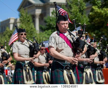Group Of People On The Pipes