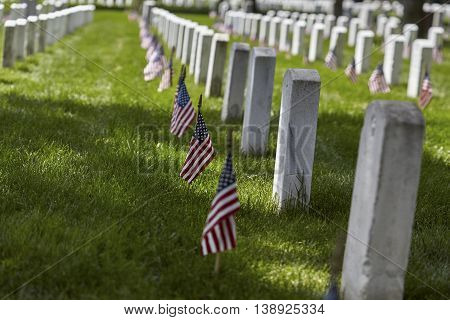 United States Flag on gravesites at Arlington National Cemetery on Memorial Day