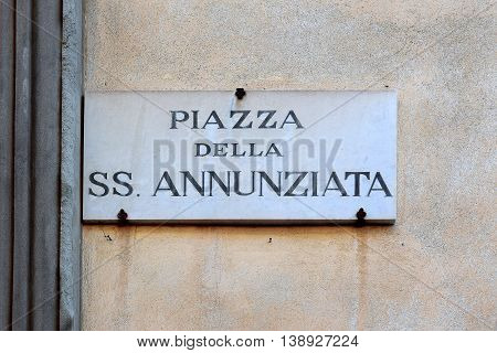 Piazza della Santissima Annunziata, street plate on a wall of old house in Florence, region of Tuscany, Italy