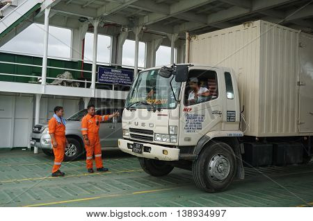 Labuan,Malaysia-July 15,2016:Motor vehicles line up and parking in the ferry.Ferry services to mainland Sabah via the Labuan ferry have improved with additional trips provided by the ferry operators