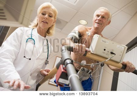 Doctor With Patient While They Run Being Monitored