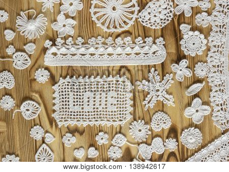 Handmade white crochet frame pattern knitting sewing. Homemade colorful backdrop with flowers hearts. Background for sketchbook notebook Christmas yuletide Valentine's day. Text Love