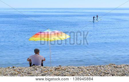 People enjoy summer on Jurassic Coast in Beer Devon