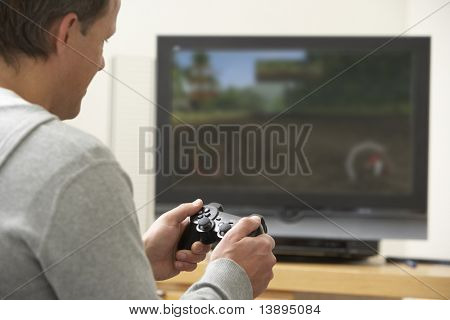 Man Playing With Game Console