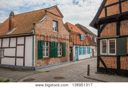 Narrow Cobblestoned Street With Small Houses In Travemunde