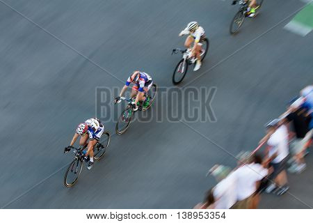 Fast Bikers Make Way Past Crowd