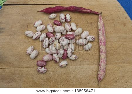 Borlotti Beans Peeled On Wooden Cutting Board.