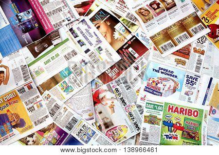 Colorado, USA - July 13, 2016: Studio shot of a pile of manufacturer coupons.