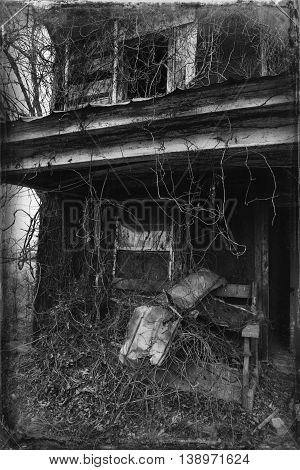 Porch of abandoned house in Appalachia with overgrown vines, Chilhowie, Virginia