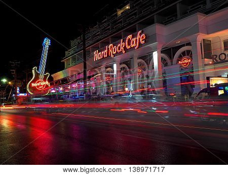 Hard Rock Cafe.  Fhuket, Thailand - May 28, 2016 Night, blurred car traffic in front of a music club Hard Rock Cafe in Fhuket in Thailand.