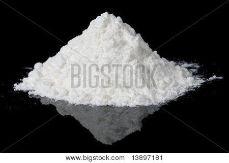 White Powder On Black Reflective Surface