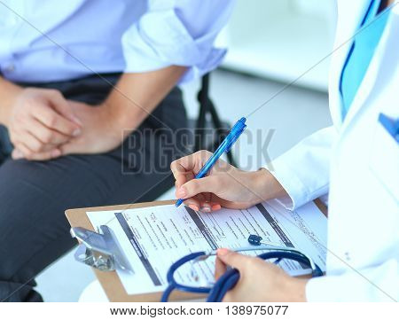 Doctor woman sitting with  male patient at the desk .