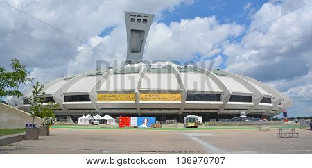 MONTREAL QUEBEC CANADA JULY 15 2016: The Montreal Olympic Stadium and tower. It's the tallest inclined tower in the world.Tour Olympique stands 175 meters tall and at a 45-degree angle