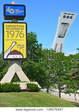 MONTREAL QUEBEC CANADA 06 15 16: Montreal olympic 40th anniversary expo sign and the olympic stadium tower the tallest inclined tower in the world.