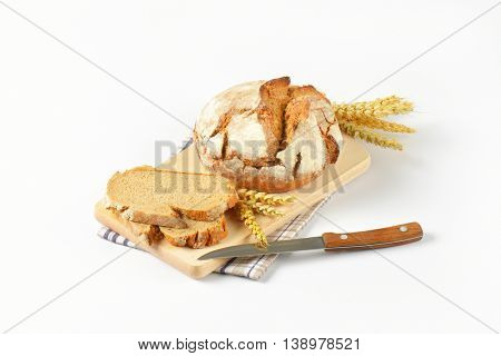 round loaf of bread on cutting board