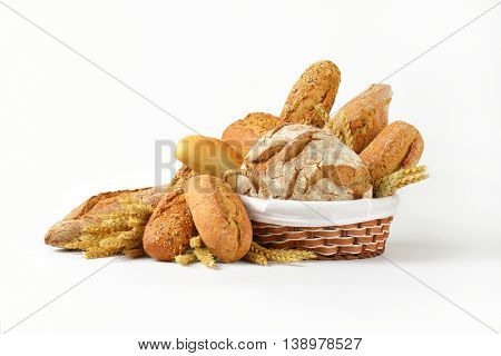 Various types of bread in a basket and next to it