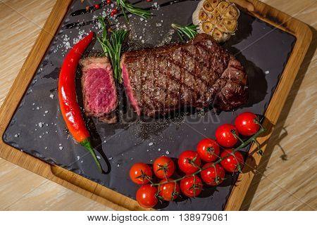Steak New York tomato garlic and rosemary