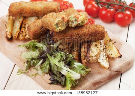 Breaded veggie sticks with roasted potato wedges