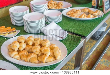 Croissant bread on table in buffet