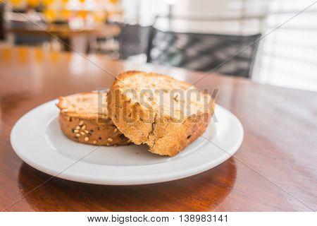 Toast bread in a white plate
