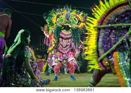 BAMNIA PURULIA WEST BENGAL INDIA - DECEMBER 23RD 2015 : Dancers dressed as monster performing at Chhau Dance festival. It is Indian tribal martial dance performed amongst spectators.