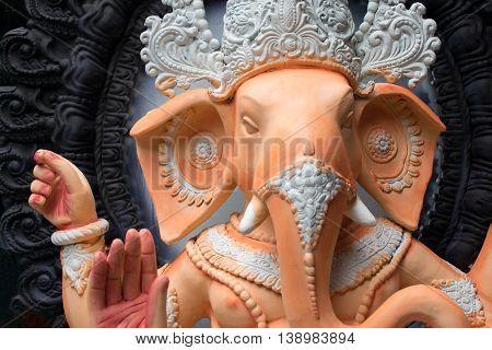 KOLKATA WEST BENGAL INDIA - 13 SEPTEMBER 2015: Beautiful fresh painted clay idol of Lord Ganesha at Kumartuli as preparation for