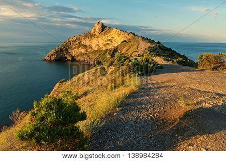 Beautiful Cape Kapchik in Black Sea illuminated the rising sun. Crimea.