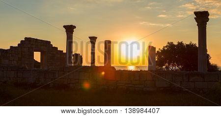 Ancient Greek basilica and marble columns in Chersonesus Taurica on the sunset background. Sevastopol, Crimea. Russia