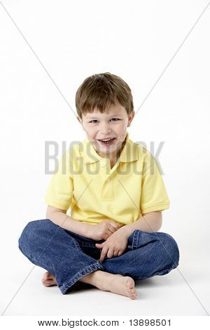 Young Boy Sitting In Studio