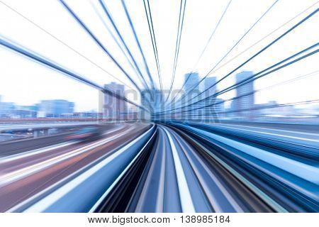 blur railway track and cityscape from speed train in tokyo