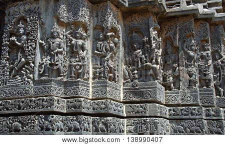 God Goddess and dancers carved in Hoysaleshwara temple at Halebidu Hassan district Karnataka state India Asia
