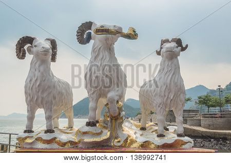 REPULSE BAY HONG KONG - MAY 23: The statues of three celestial rams presenting the jade scepter of prosperity to the people of Hong Kong in Kwun Yam temple on May 23 2016 in Repulse Bay Hong Kong.