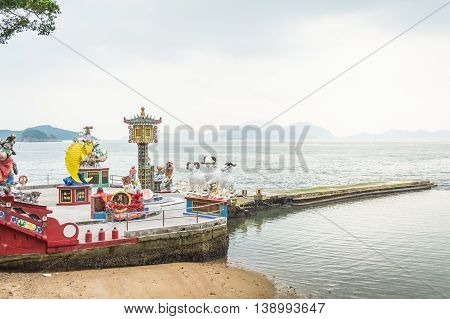REPULSE BAY HONG KONG - MAY 23: Many beautiful statues and the sea at Kwun Yam temple on May 23 2016 in Repulse Bay Hong Kong.