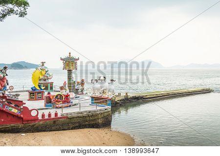 REPULSE BAY HONG KONG - MAY 23: Many beautiful statues and the sea at Kwun Yam temple on May 23 2016 in Repulse Bay Hong Kong.