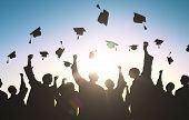 education, graduation and people concept - silhouettes of many happy students in gowns throwing mortarboards in air poster