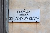 Piazza della Santissima Annunziata, street plate on a wall of old house in Florence, region of Tuscany, Italy poster