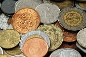 Assorted foreign coins close up in macro poster