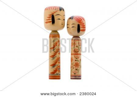 Japanese Kokeshi Dolls On White Background