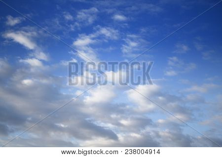 Bright blue sky background. Spring sky. Blue sky and white clouds. Beautiful sky. Skyground. Sky style. Sky pattern.