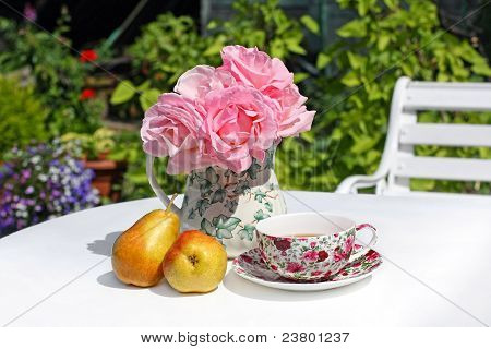 Lovey Summer Gareden With Pink Roses And Pears On White Table