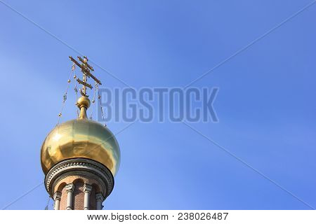 Religious Architecture Detail - Golden Dome Of Christian Orthodox Church On Clear Blue Sky Backgroun
